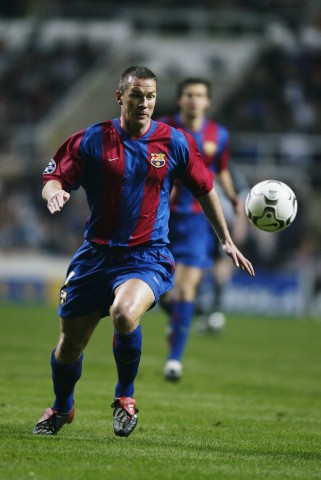 Patrik Andersson of Barcelona chases the ball