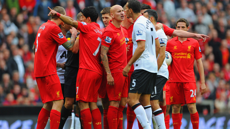 LIVERPOOL, ENGLAND - SEPTEMBER 23: Jonjo Shelvey of Liverpool argues with Rio Ferdinand of Manchester United before being sent off during the Barclays Premier League match between Liverpool and Manchester United at Anfield on September 23, 2012 in Liverpool, England.  (Photo by Michael Regan/Getty Images)