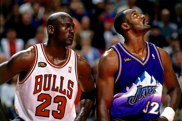 CHICAGO - JUNE 7: Michael Jordan #23 of the Chicago Bulls matches up against Karl Malone #32 of the Utah Jazz in Game Three of the 1998 NBA Finals at the United Center on June 5, 1998 in Chicago, Illinois. The Bulls won 96-54. NOTE TO USER: User expressly acknowledges that, by downloading and or using this photograph, User is consenting to the terms and conditions of the Getty Images License agreement. Mandatory Copyright Notice: Copyright 1998 NBAE (Photo by Andrew D. Bernstein/NBAE via Getty Images)