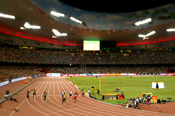 BEIJING, CHINA - AUGUST 27: (EDITORS NOTE: A variable plane lens was used in the creation of this image) Usain Bolt of Jamaica crosses the finish line to win gold in the Men's 200 metres final during day six of the 15th IAAF World Athletics Championships Beijing 2015 at Beijing National Stadium on August 27, 2015 in Beijing, China. (Photo by Cameron Spencer/Getty Images)