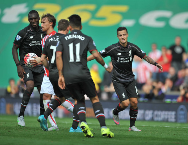 Liverpool Celebrate the only Goal at Stoke by Phillipe Coutino...