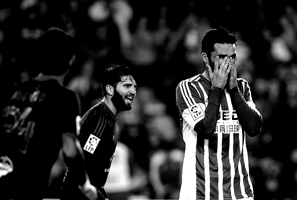 Betis' defender Jorge Molina (R) covers his face with hands after missing a goal during the Spanish league football match Real Betis vs RC Celta de Vigo at the Benito Villamarin stadium in Sevilla on December 5, 2015.The match enden in a draw 1-1. AFP PHOTO / CRISTINA QUICLER / AFP / CRISTINA QUICLER (Photo credit should read CRISTINA QUICLER/AFP/Getty Images)