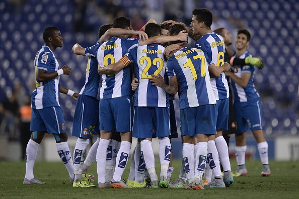 Espanyol's players celebrate after winning the Spanish league football match RCD Espanyol vs Valencia CF at the Power8 stadium in Cornella de Llobregat on September 22, 2015.   AFP PHOTO/ JOSEP LAGO        (Photo credit should read JOSEP LAGO/AFP/Getty Images)