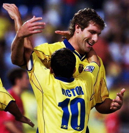 SEVILLE - SEPTEMBER 1: Martin Palermo and Victor of Villarreal celebrate a goal during the Villareal v Osasuna Primera Liga match played at the El Madrigal Stadium, Villareal, Spain. (Photo by Firo Foto/Getty Images)