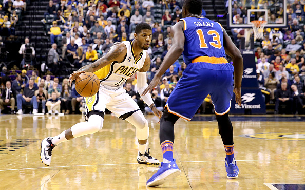 INDIANAPOLIS, INDIANA - APRIL 12: Paul George #13 of the Indiana Pacers dribbles the ball during the game against the New York Knicks at Bankers Life Fieldhouse on April 12, 2016 in Indianapolis, Indiana. NOTE TO USER: User expressly acknowledges and agrees that, by downloading and or using this photograph, User is consenting to the terms and conditions of the Getty Images License Agreement. (Photo by Andy Lyons/Getty Images)