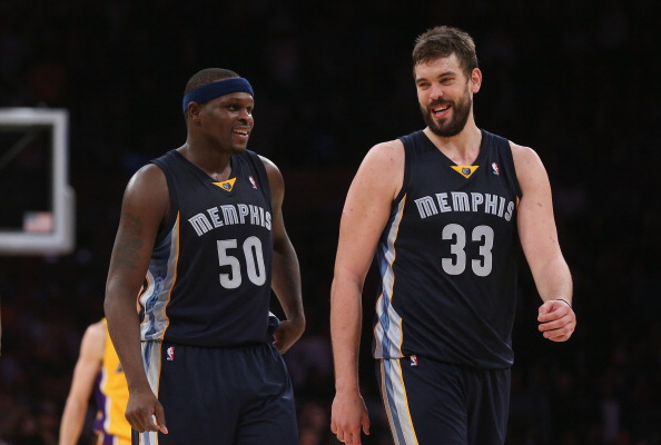 LOS ANGELES, CA - NOVEMBER 15: Zach Randolph #50 and Marc Gasol #33 of the Memphis Grizzlies share a laugh in the closing minutes of the game against the Los Angeles Lakers at Staples Center on November 15, 2013 in Los Angeles, California. The Grizzlies defeated the Lakers 89-86. NOTE TO USER: User expressly acknowledges and agrees that, by downloading and or using this photograph, User is consenting to the terms and conditions of the Getty Images License Agreement. (Photo by Jeff Gross/Getty Images)
