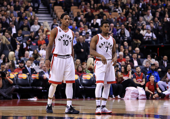 TORONTO, ON - APRIL 12: DeMar DeRozan #10 and Kyle Lowry #7 of the Toronto Raptors looks on during the second half of an NBA game against the Philadelphia 76ers at the Air Canada Centre on April 12, 2016 in Toronto, Ontario, Canada. NOTE TO USER: User expressly acknowledges and agrees that, by downloading and or using this photograph, User is consenting to the terms and conditions of the Getty Images License Agreement. (Photo by Vaughn Ridley/Getty Images)