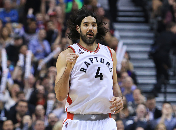 TORONTO, ON - MARCH 18: Luis Scola #4 of the Toronto Raptors celebrates after sinking a 3-pointer during the first half of an NBA game against the Boston Celtics at the Air Canada Centre on March 18, 2016 in Toronto, Ontario, Canada. NOTE TO USER: User expressly acknowledges and agrees that, by downloading and or using this photograph, User is consenting to the terms and conditions of the Getty Images License Agreement. (Photo by Vaughn Ridley/Getty Images)