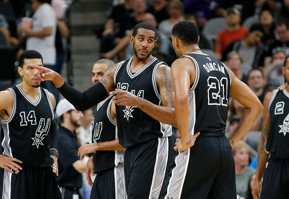 SAN ANTONIO, TX - OCTOBER 30: LaMarcus Aldridge #12 and Tim Duncan #21 of the San Antonio Spurs talk during the game with the Brooklyn Nets at the AT&T Center on October 30, 2015 in San Antonio, Texas. NOTE TO USER: User expressly acknowledges and agrees that, by downloading to the terms and conditions of the Getty Images License Agreement. (Photo by Chris Covatta/Getty Images)