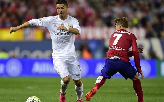 Real Madrid y Atlético, durante un partido