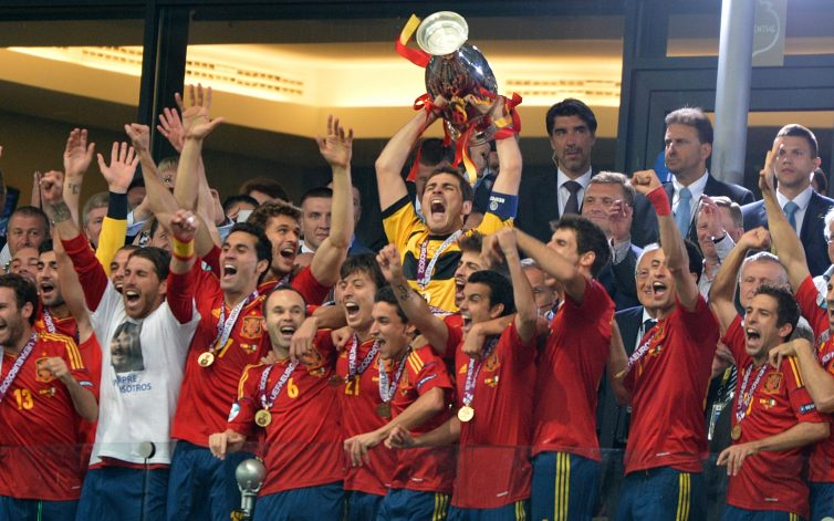 Spanish players celebrate with the trophy after winning the Euro 2012 football championships final match Spain vs Italy on July 1, 2012 at the Olympic Stadium in Kiev. AFP PHOTO / GABRIEL BOUYS
