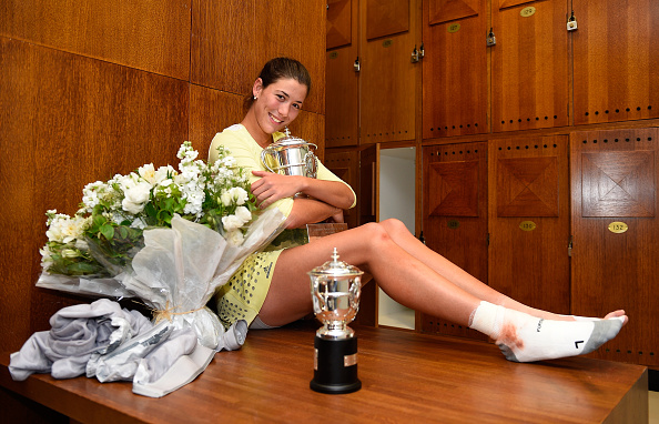 PARIS, FRANCE - JUNE 04:  Garbine Muguruza of Spain poses with the trophy following her victory during the Ladies Singles final match against Serena Williams of the United States on day fourteen of the 2016 French Open at Roland Garros on June 4, 2016 in Paris, France.  (Photo by C. Dubreil-FFT/Pool/Getty Images)