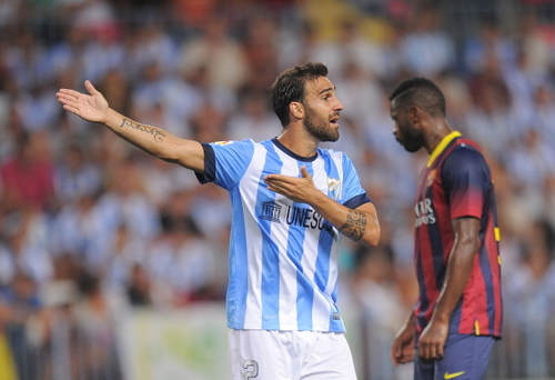 MALAGA, SPAIN - AUGUST 25: Jesus Gamez of Malaga CF reacts during the La Liga match between Malaga CF and FC Barcelona at La Rosaleda Stadium on August 25, 2013 in Malaga, Spain. (Photo by Denis Doyle/Getty Images)