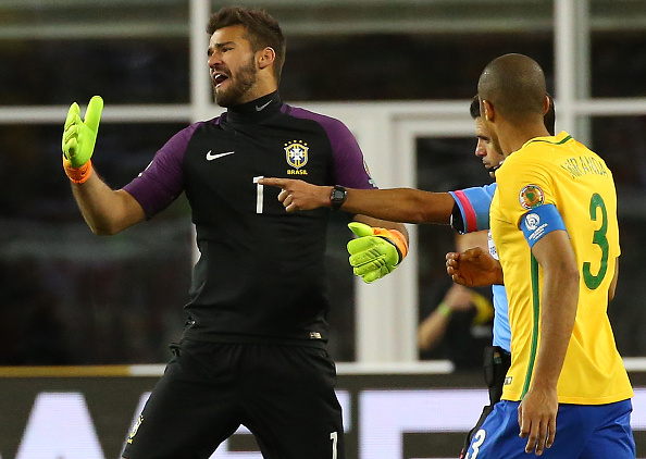 FOXBORO, MA - JUNE 12: Alisson Becker #1 of Brazil reacts after a shot on net by Raul Ruidiaz #11 of Peru was ruled a goal by an official in the second half during the 2016 Copa America Centenario Group B match against Brazil at Gillette Stadium on June 12, 2016 in Foxboro, Massachusetts. (Photo by Jim Rogash/Getty Images)