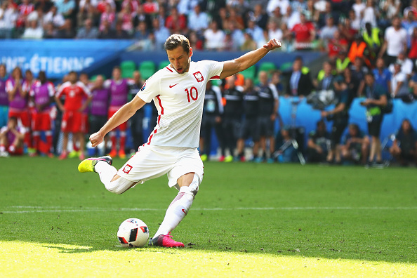 SAINT-ETIENNE, FRANCE - JUNE 25: Grzegorz Krychowiak of Poland scores at the penalty shootout to win the game during the UEFA EURO 2016 round of 16 match between Switzerland and Poland at Stade Geoffroy-Guichard on June 25, 2016 in Saint-Etienne, France. (Photo by Lars Baron/Getty Images)