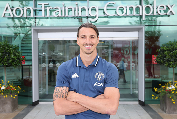 MANCHESTER, ENGLAND - JULY 01: (MINIMUM FEES APPLY - MINIMUM PRINT/BROADCAST FEE OF 150 GBP, ONLINE FEE OF 75 GBP, OR LOCAL EQUIVALENT) (EXCLUSIVE COVERAGE) Zlatan Ibrahimovic of Manchester United poses after signing for the club at Aon Training Complex on July 1, 2016 in Manchester, England. (Photo by John Peters/Man Utd via Getty Images)