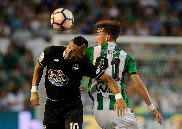 Deportivo La Coruna's midfielder Florin Andone (L) vies with Betis' midfielder Fabian during the Spanish league football match Real Betis Balompie versus Deportivo La Coruna at the Benito Villamarin stadium in Sevilla on August 26, 2016. / AFP / CRISTINA QUICLER (Photo credit should read CRISTINA QUICLER/AFP/Getty Images)