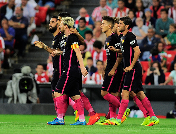 Barcelona's players celebrate after scoring the opener during the Spanish league football match Athletic Club Bilbao vs FC Barcelona at the San Mames stadium in Bilbao on August 28, 2016. / AFP / ANDER GILLENEA (Photo credit should read ANDER GILLENEA/AFP/Getty Images)
