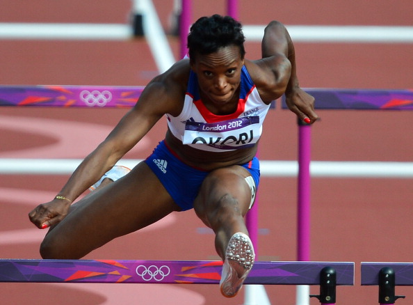 France's Reina-Flor Okori competes in the women's 100m hurdles heats at the athletics event of the London 2012 Olympic Games on August 6, 2012 in London. AFP PHOTO / GABRIEL BOUYS (Photo credit should read GABRIEL BOUYS/AFP/GettyImages)