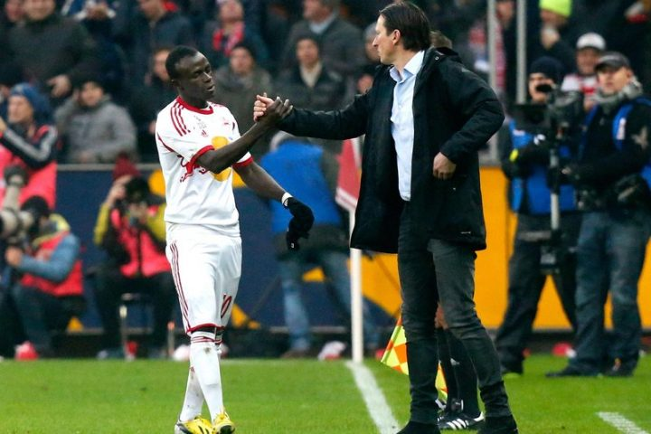 GEPA-18011440049 - SALZBURG,AUSTRIA,18.JAN.14 - SOCCER - tipp3 Bundesliga powered by T-Mobile, DFL, 1. Deutsche Bundesliga, Red Bull Salzburg vs FC Bayern Muenchen, friendly match. Image shows the rejoicing of Sadio Mane and head coach Roger Schmidt (RBS). Photo: GEPA pictures/ David Rodriguez Anchuelo - For editorial use only. Image is free of charge.