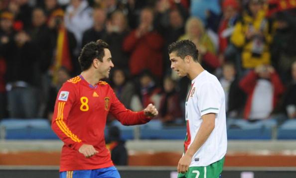 Spain's midfielder Xavi (L) celebrates p