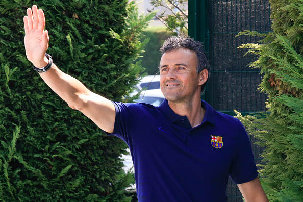 Barcelona's coach Luis Enrique Martinez waves on arrival to a press conference after a training session at the Sports Center FC Barcelona Joan Gamper in Sant Joan Despi, near Barcelona on August 19, 2016 / AFP / PAU BARRENA        (Photo credit should read PAU BARRENA/AFP/Getty Images)