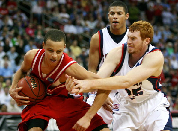 RALEIGH, NC - MARCH 21: Stephen Curry #30 of the Davidson Wildcats draws a foul from David Pendergraft #25 of the Gonzaga Bulldogs during the 1st round of the 2008 NCAA Men's Basketball Tournament on March 21, 2008 at RBC Center in Raleigh, North Carolina. Davidson defeated Gonzaga 82-76. (Photo by Kevin C. Cox/Getty Images)