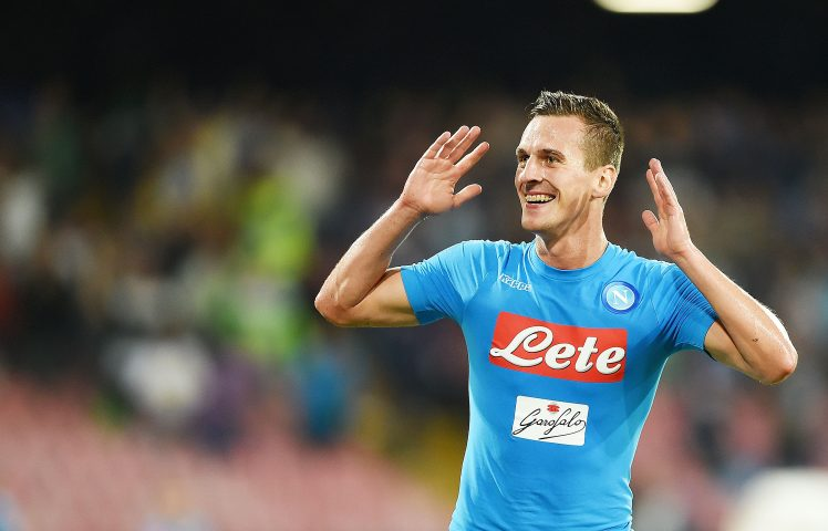 NAPLES, ITALY - SEPTEMBER 17: Arkadiusz Milik of Napoli celebrates after scoring goal 3-1 during the Serie A match between SSC Napoli and Bologna FC at Stadio San Paolo on September 17, 2016 in Naples, Italy. (Photo by Francesco Pecoraro/Getty Images)