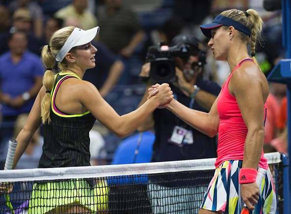 Catherine Bellis of the US (L) and Angelique Kerber of Germany meet at the net after their 2016 US Open women's singles match at the USTA Billie Jean King National Tennis Center on September 2, 2016 in New York. / AFP / Don EMMERT        (Photo credit should read DON EMMERT/AFP/Getty Images)