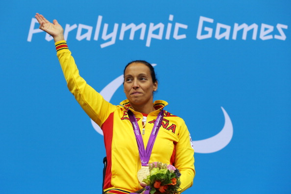 LONDON, ENGLAND - SEPTEMBER 08: Gold medallist Teresa Perales of Spain poses on the podium during the medal ceremony for the Women's 100m Freestyle - S5 final on day 10 of the London 2012 Paralympic Games at Aquatics Centre on September 8, 2012 in London, England. (Photo by Clive Rose/Getty Images)
