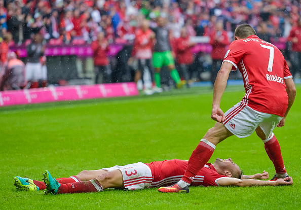 Bayern Munich's Brazilian defender Rafinha (Bottom) celebrates his goal with Bayern Munich's French midfielder Franck Ribery (R) during the German first division Bundesliga football match of Bayern Munich vs FC Ingolstadt in Munich, southern Germany, on September 17, 2016. / AFP / GUENTER SCHIFFMANN / RESTRICTIONS: DURING MATCH TIME: DFL RULES TO LIMIT THE ONLINE USAGE TO 15 PICTURES PER MATCH AND FORBID IMAGE SEQUENCES TO SIMULATE VIDEO. == RESTRICTED TO EDITORIAL USE == FOR FURTHER QUERIES PLEASE CONTACT DFL DIRECTLY AT + 49 69 650050 (Photo credit should read GUENTER SCHIFFMANN/AFP/Getty Images)