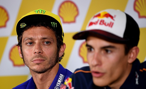 Movistar Yamaha MotoGP's Italian rider Valentino Rossi (L) looks on as Repsol Honda Team's Spanish rider Marc Marquez (R)addresses a press conference ahead of the 2016 MotoGP Malaysian Grand Prix at Sepang International Circuit on October 27, 2016. / AFP / MANAN VATSYAYANA        (Photo credit should read MANAN VATSYAYANA/AFP/Getty Images)