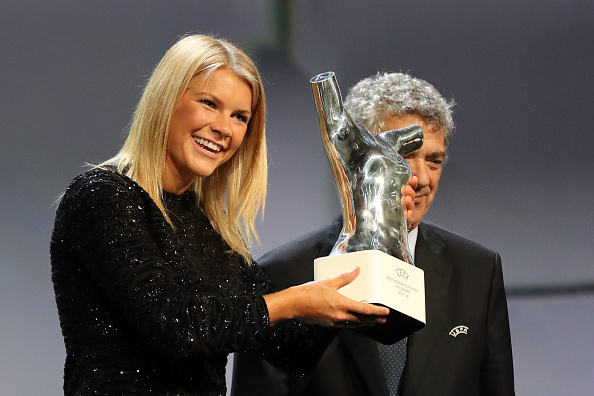 Lyon's Norwegian forward Ada Hegerberg holds her trophy of Best Women's player in Europe at the end of the UEFA Champions League Group stage draw ceremony, on August 25, 2016 in Monaco. / AFP / Valery HACHE (Photo credit should read VALERY HACHE/AFP/Getty Images)